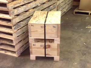 Strapped and stacked custom wood crating